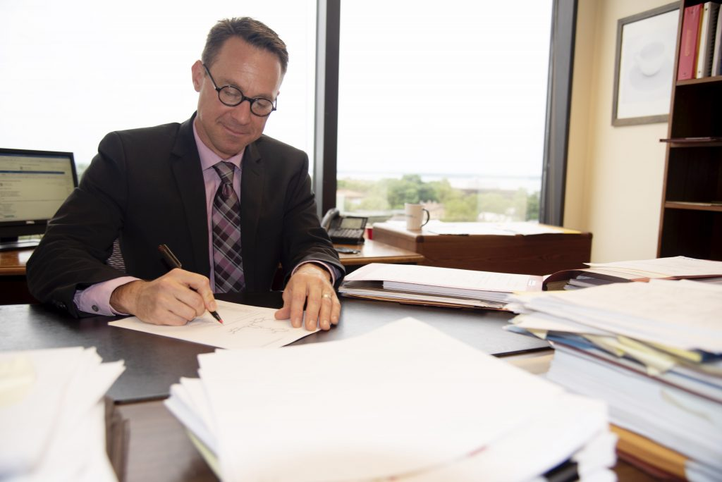 Photo of patent agent Dan Blasiole at desk